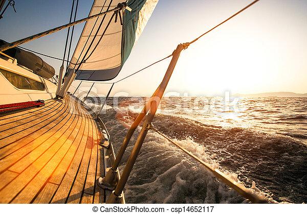 Sailing regatta, during sunset. - csp14652117
