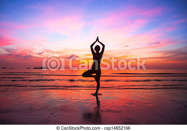 Silhouette woman yoga practice at the seaside at sunset. - csp14652166