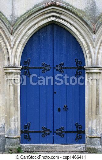 blue church door in stone archway - csp1466411