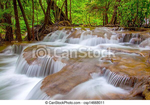 Waterfall in deep rain forest jungle. (Huay Mae Kamin Waterfall in Kanchanaburi Province, Thailand) - csp14668011