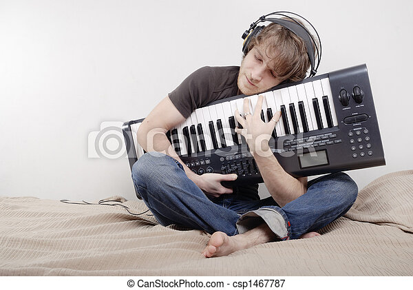 Man hugs a MIDI-keyboard - csp1467787