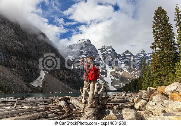 Hiking Man Looking at Moraine Lake & Rocky Mountains - csp14681280