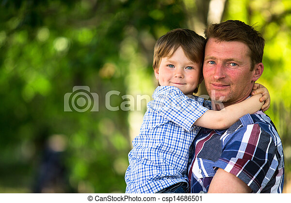 Portrait of father and son in the park - csp14686501