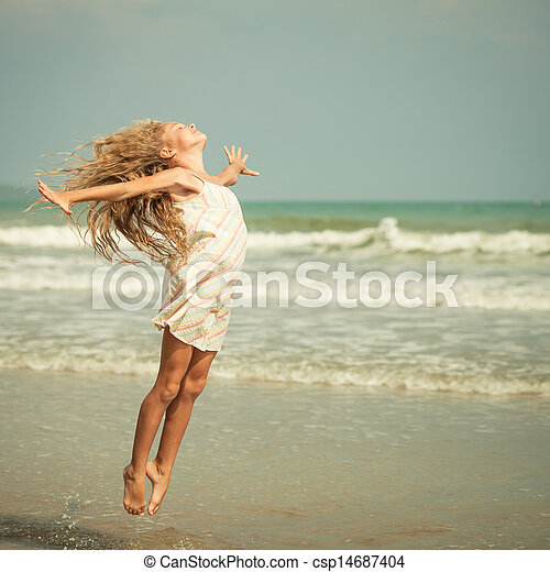 flying jump beach girl on blue sea shore in summer vacation - csp14687404