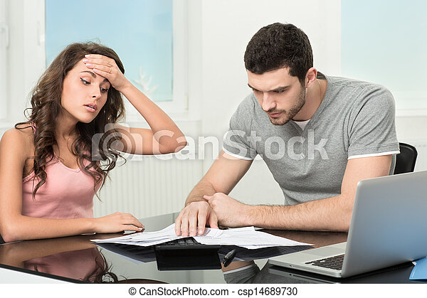 man upset after looking at card statement. - csp14689730