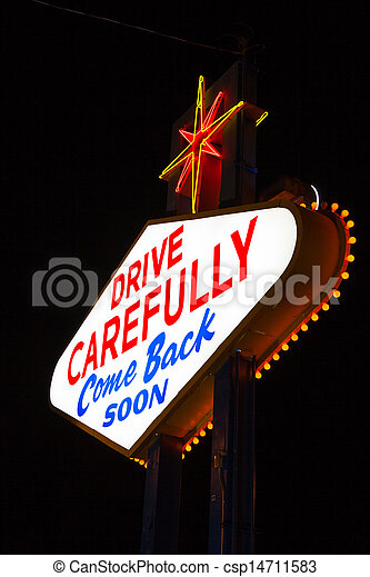 Famous Leaving Las Vegas sign at night - csp14711583