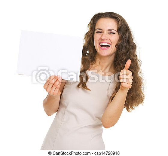 Smiling young woman showing blank paper and thumbs up - csp14720918