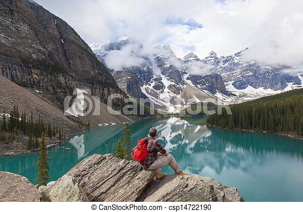 Hiking Man Looking at Moraine Lake & Rocky Mountains - csp14722190