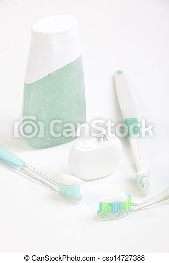 Toothbrush and dental floss isolated on white - csp14727388