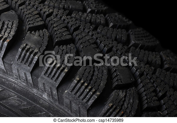 Automobile tire on black background - csp14735989