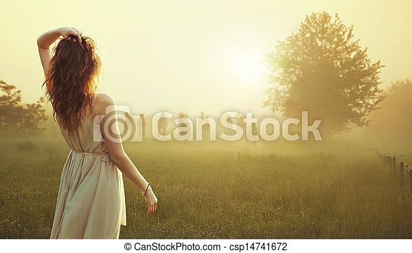 Young brunette lady watching herd of horses - csp14741672