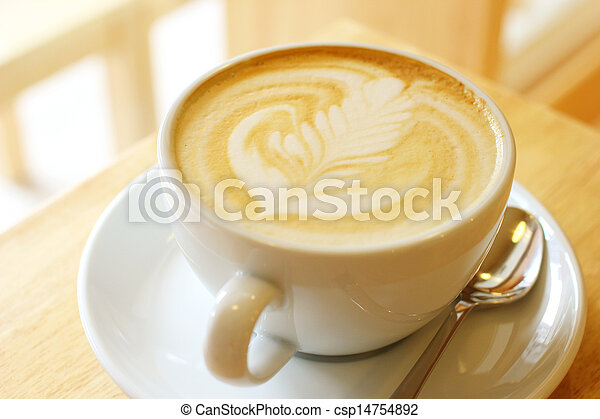 Cup of art latte or cappuccino coffee  - csp14754892
