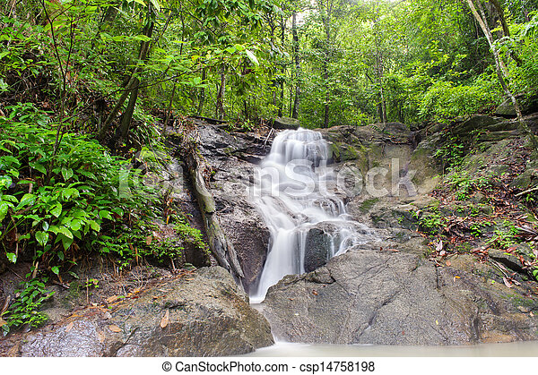 Waterfall in tropical rain forest jungle. Thailand beautiful nature - csp14758198