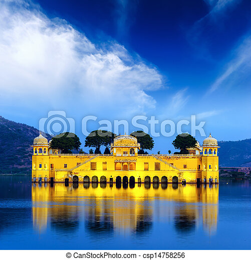 Indian water palace on Jal Mahal lake at night time in Jaipur - csp14758256