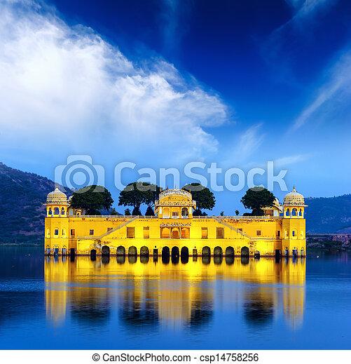 Indian water palace on Jal Mahal lake at night time in Jaipur - csp14758256