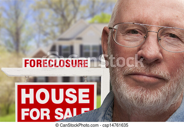 Depressed Senior Man in Front of Foreclosure Sign and House - csp14761635