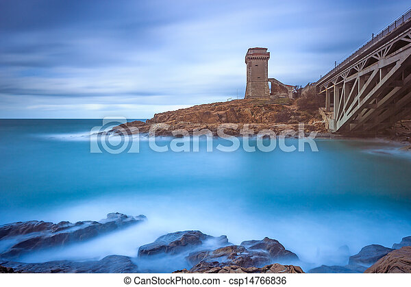 Calafuria Tower landmark on cliff rock, aurelia bridge and sea. Tuscany, Italy. Long exposure photography. - csp14766836