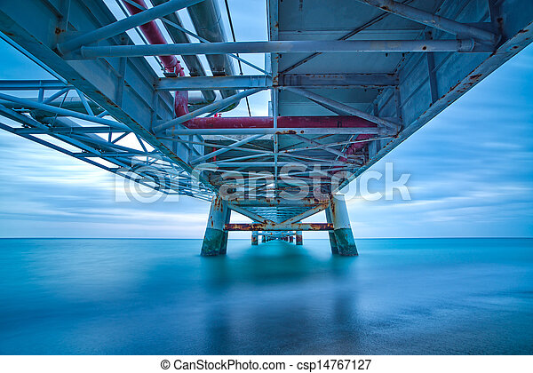 Industrial pier on the sea. Bottom view. Long exposure photography. - csp14767127