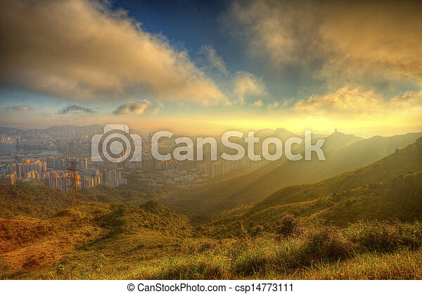 Mountain sunset in Kowloon, Hong Kong. - csp14773111