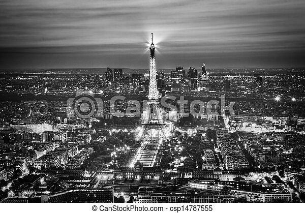 Eiffel Tower Light Performance Show at night, Paris, France. Aerial view. Black and white - csp14787555