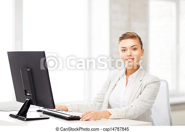 businesswoman with computer in office - csp14787845