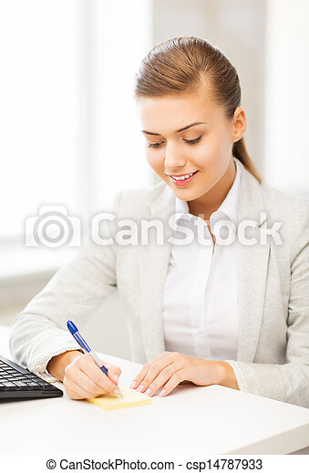 businesswoman writing on sticky note - csp14787933