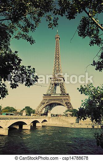 Eiffel Tower and bridge on Seine river in Paris, France. Vintage retro style - csp14788678