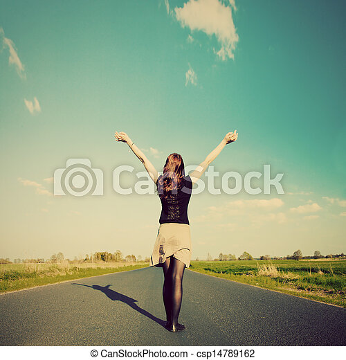 Happy woman standing on empty road. Retro vintage style - csp14789162