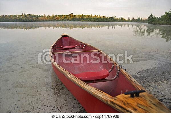 Red Canoe On Calm Lake - csp14789908