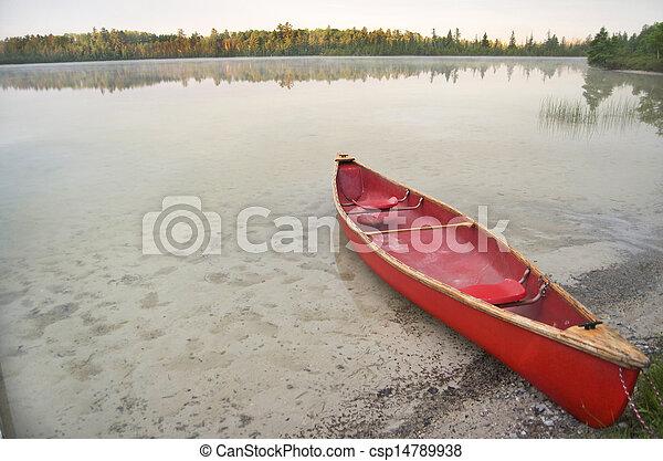 Red Canoe On Calm Lake - csp14789938