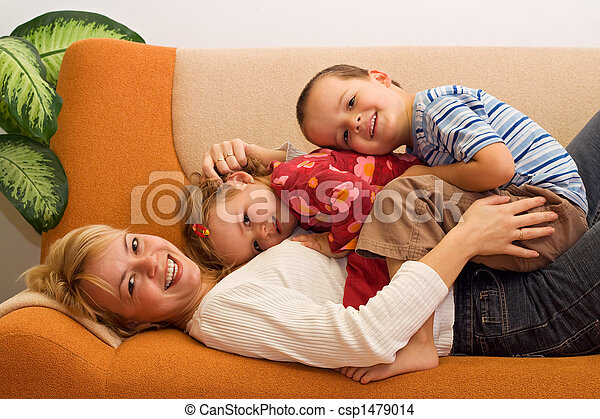 Happy woman and kids having fun indoors - csp1479014