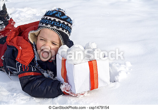 Happy boy in the snow with a box of snowballs - csp1479154