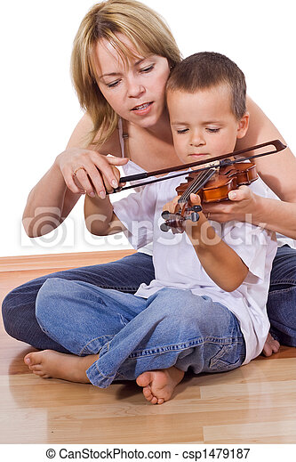 Little boy practicing the violin - csp1479187