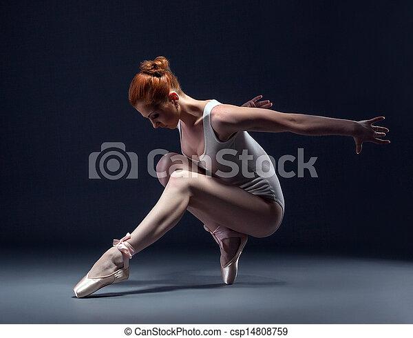 Graceful slender ballerina dancing in studio - csp14808759