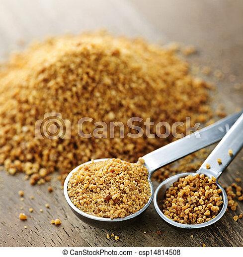 Coconut palm sugar in measuring spoons - csp14814508