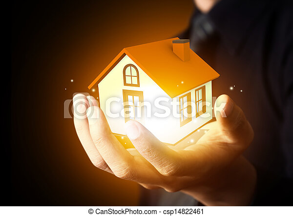 Businessman holding home model - csp14822461