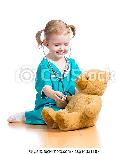 child with clothes of doctor playing with plush toy - csp14831187