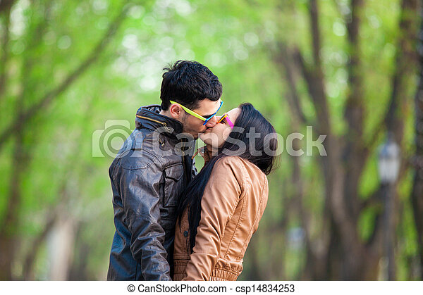 Couple kissing at alley in city. - csp14834253