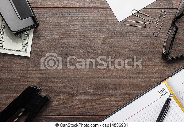 office brown wooden table with some objects - csp14836931