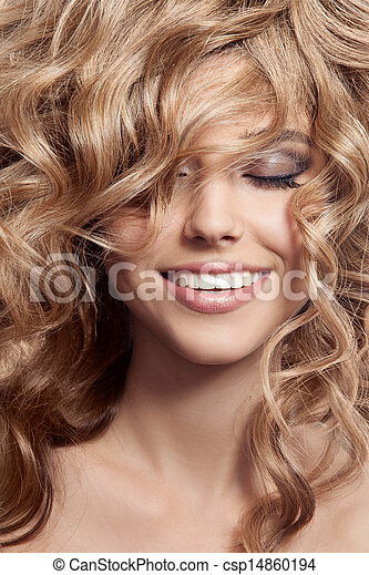 Beautiful Smiling Woman. Healthy Long Curly Hair - csp14860194