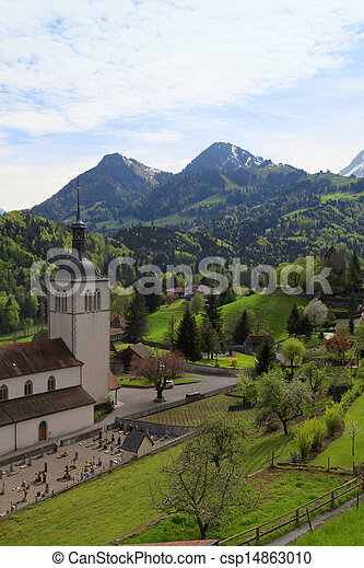 Church and Alps mountains, Gruyeres, Switzerland - csp14863010