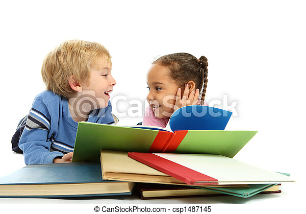 Kids laying down and reading a book - csp1487145