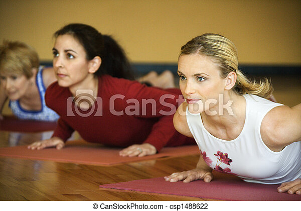 Adult females in yoga class. - csp1488622