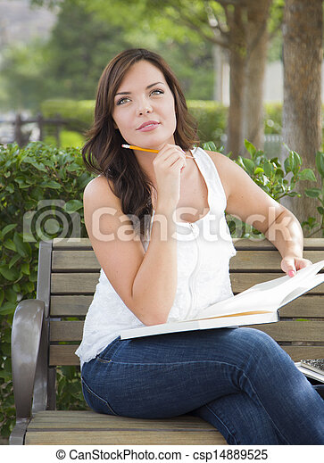 Young Adult Female Student on Bench Outdoors - csp14889525