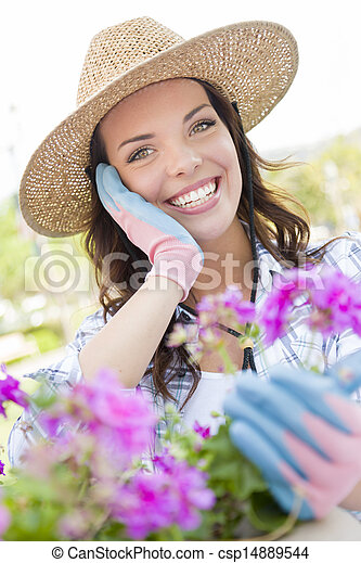 Young Adult Woman Wearing Hat Gardening Outdoors - csp14889544