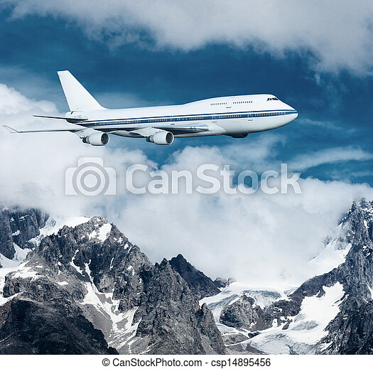 plane flying over the snow-capped mountains. - csp14895456