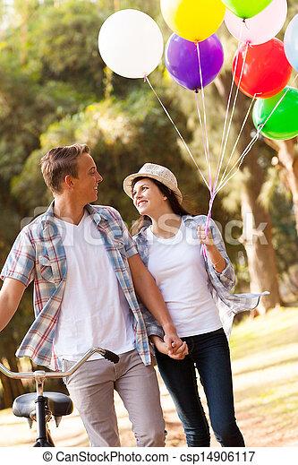 cute teen couple walking at the park - csp14906117