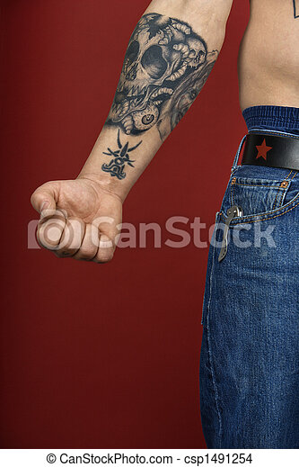 Adult male arm with tattoo.