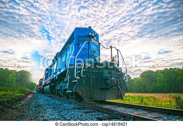 blue freight train engine at sunrise - csp14918421