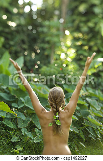 Nude woman with arms outstretched.